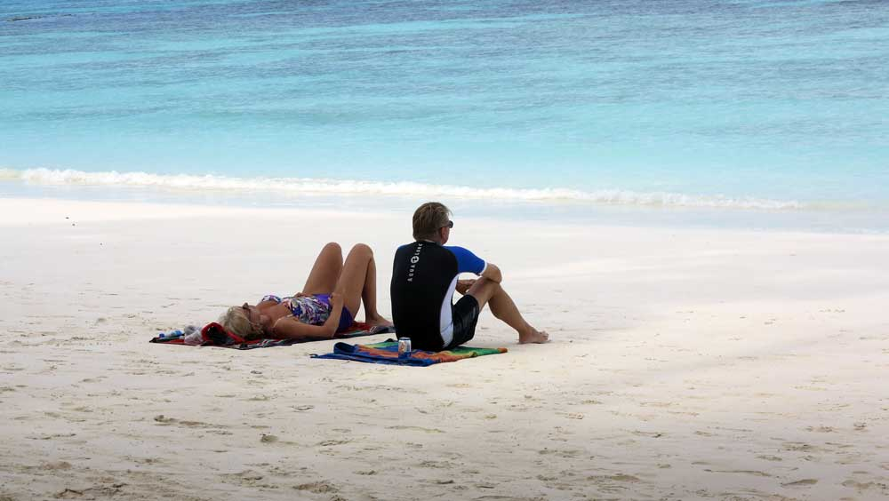 A couple enjoying the quiet Koh Tachai beach